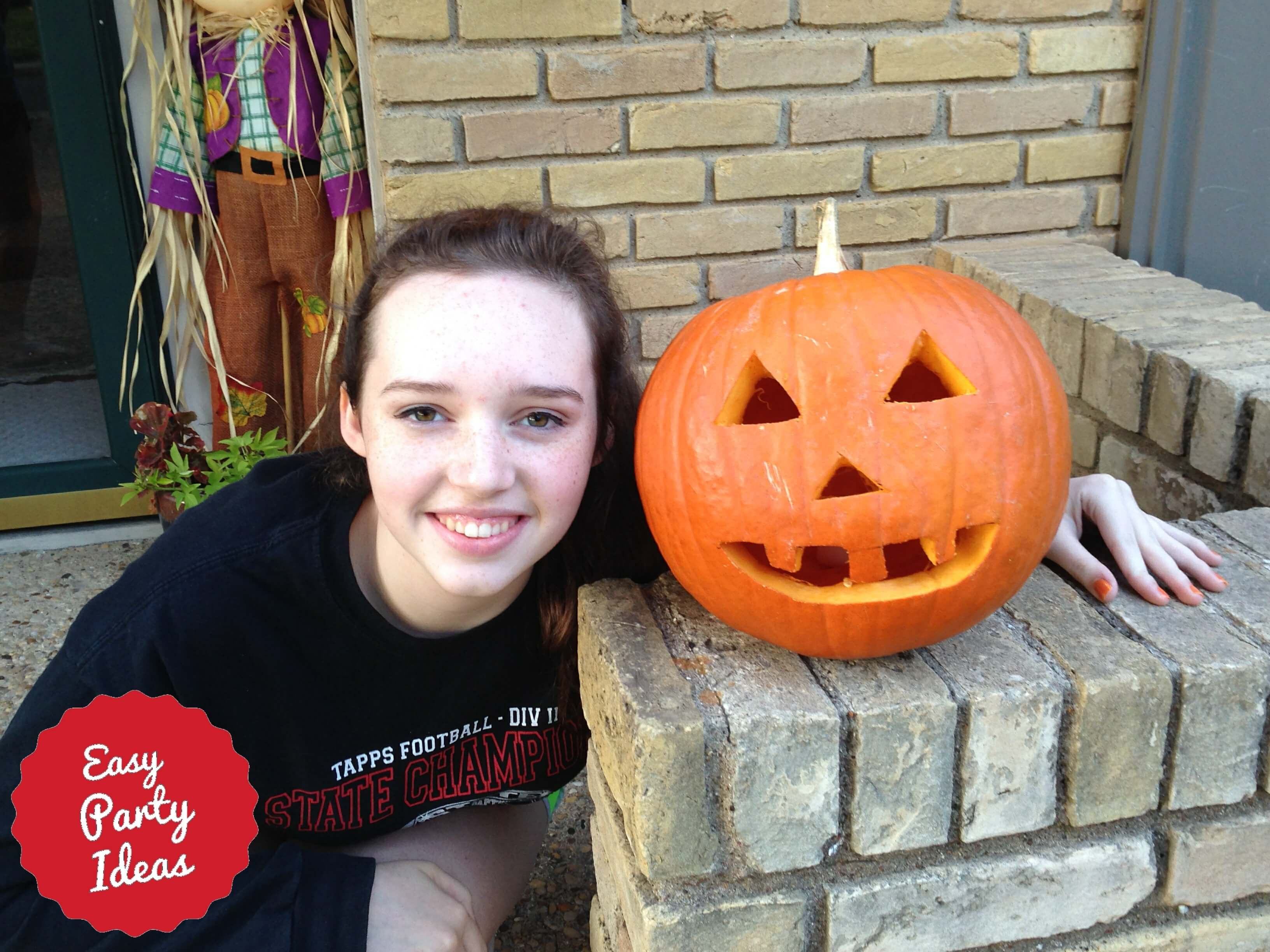 Teen with pumpkin